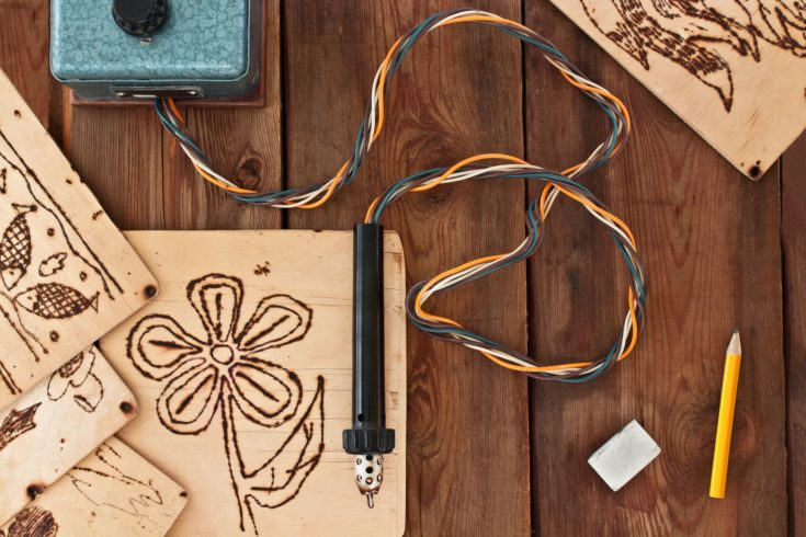 Pyrography workshop. A pyrography tool and a floral model.