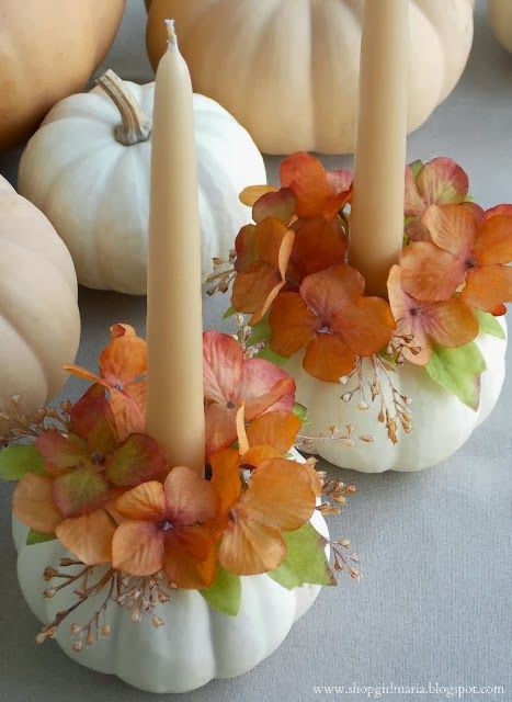 White pumpkin candle holder with cream candle and orange floral table centerpiece