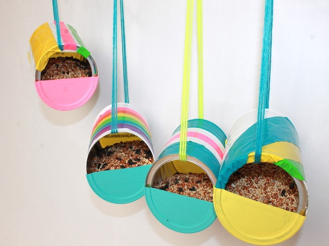 colurful Recycled Can Bird Feeder in white wall background