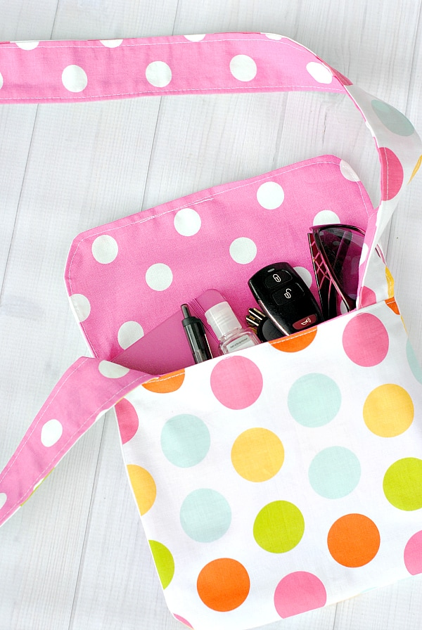 Kid's Mini Reversible Messenger Bag with colorful dots pattern