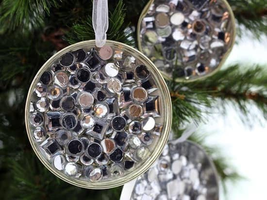 Mason Jars Lids decorated with rhinestones hang on Christmas tree