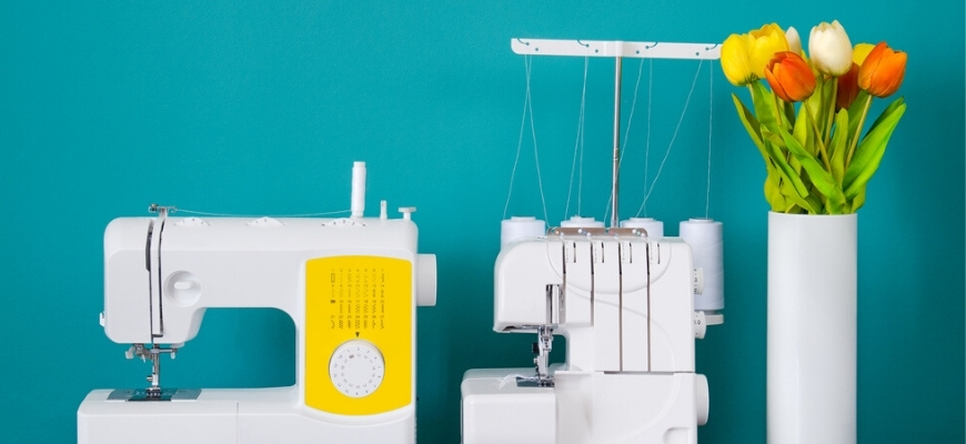 Sewing Machine and a Serger Machine side by side with flower