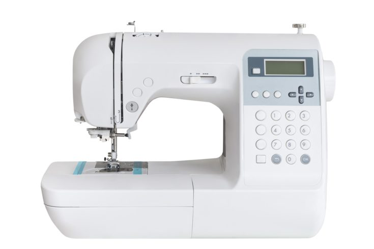 Sewing machine with a lot of buttons isolated on a white background