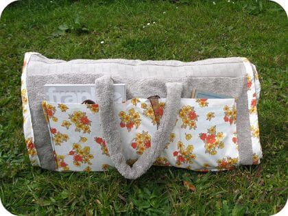 A custom shoulder bag made from towel and other materials
