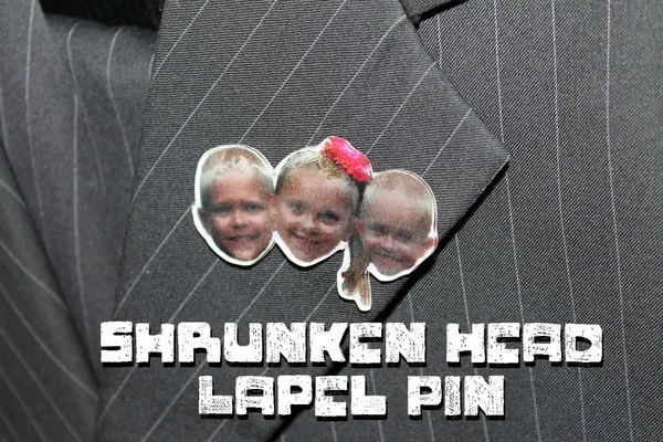 Shrunken Head Lapel Pins on a coat