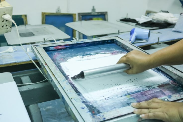 Man use screen for printing
