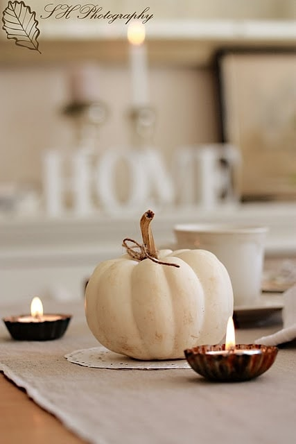 White pumpkin and candles table centerpiece