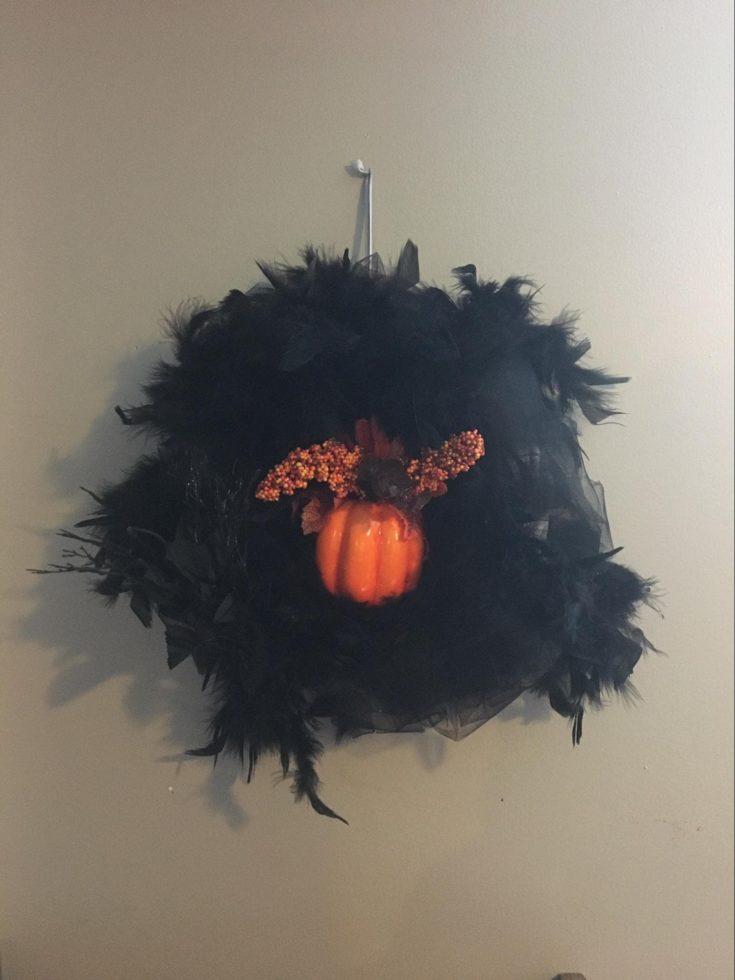 a custom made Spooky Door Wreath hanged on the wall