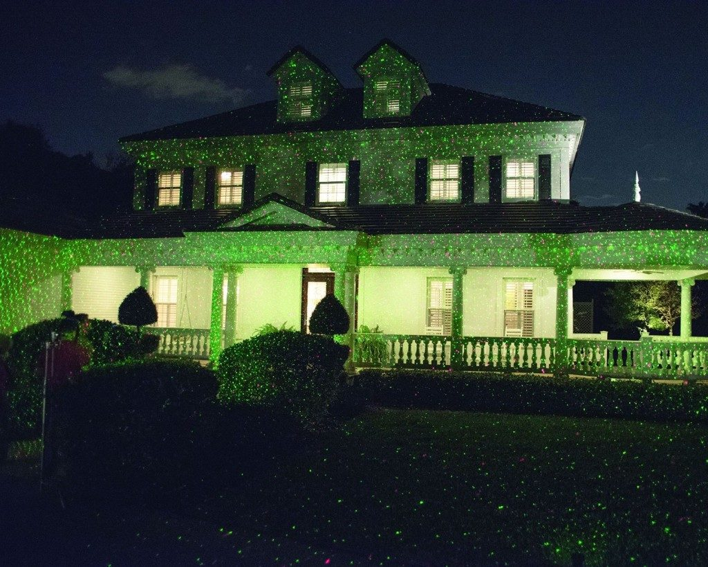 House covered in green Star Shower lights