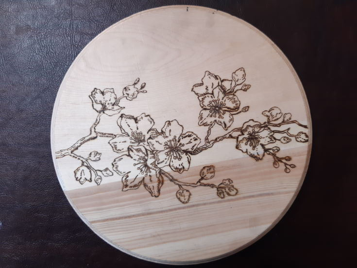 round wood with flower design