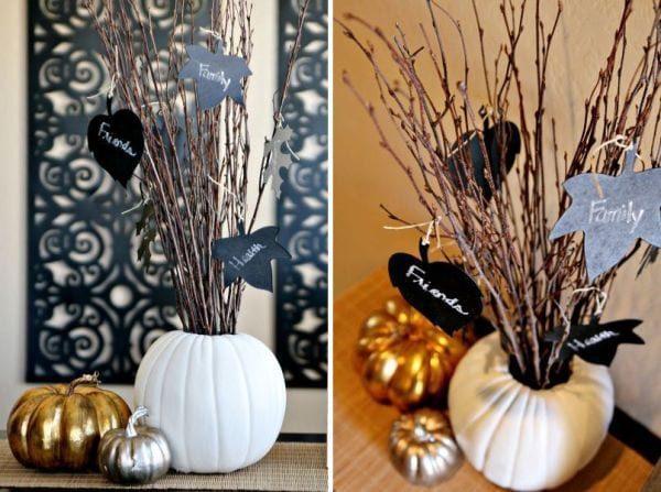 Natural wood brown sticks with white pumpkin centerpiece