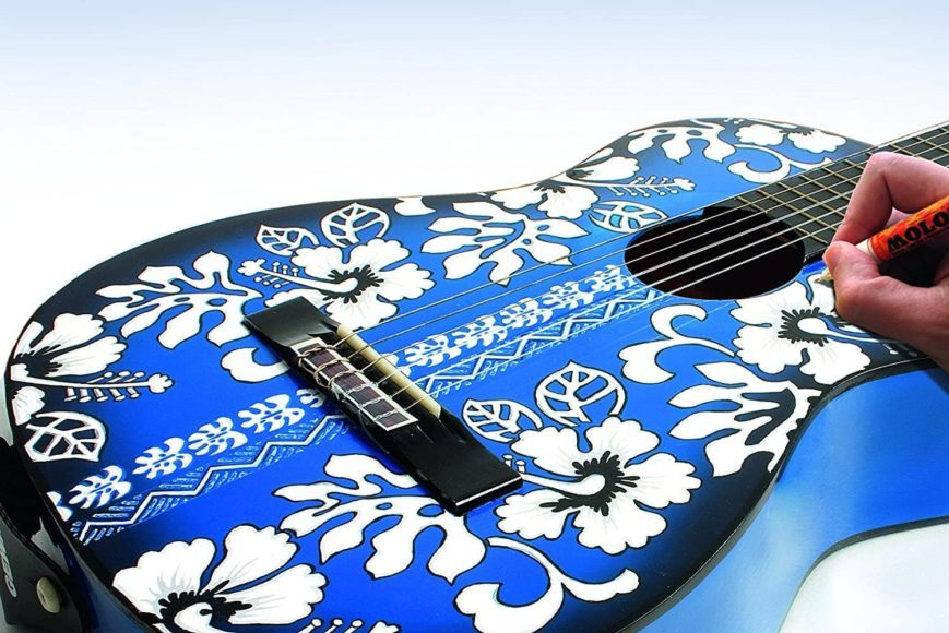 Man's hand painting the blue guitar