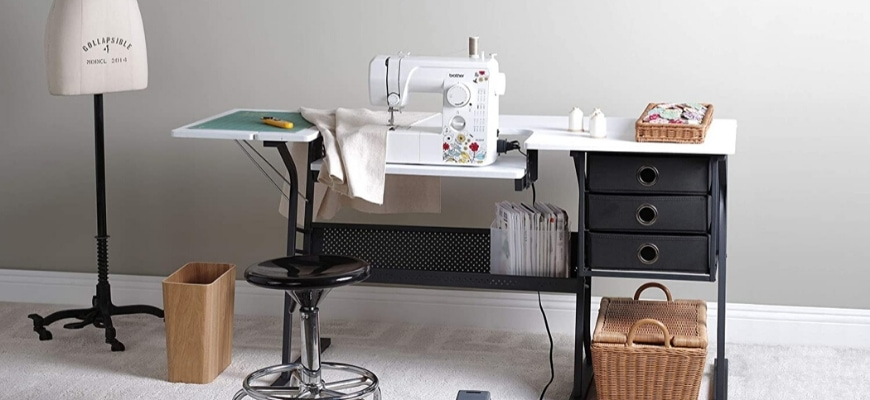 Sewing machine on a stylish portable sewing table with chair and sewing materials.