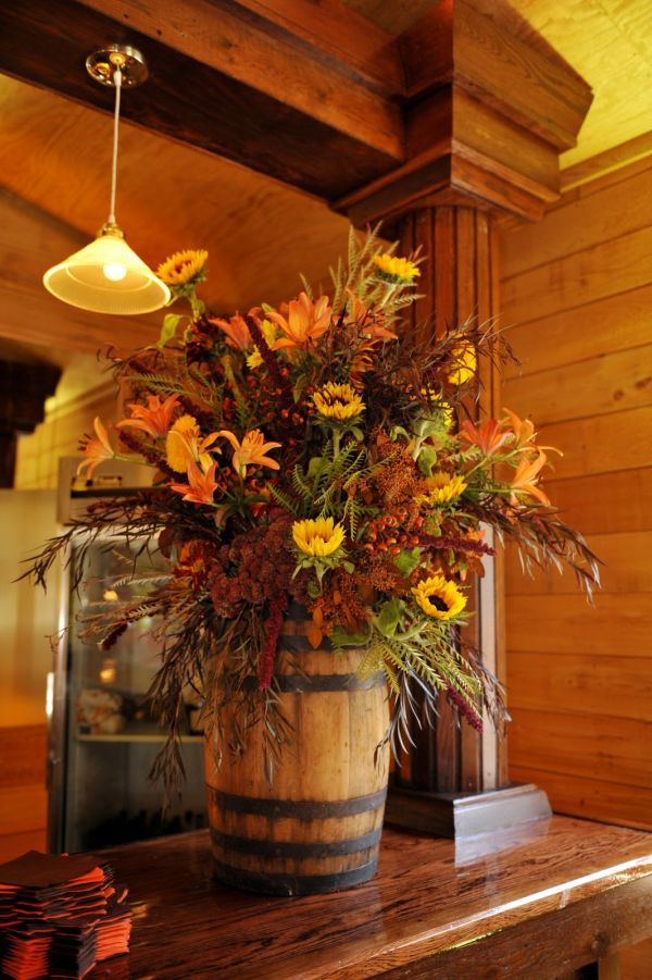 Flowers in a barrel country chic centerpiece