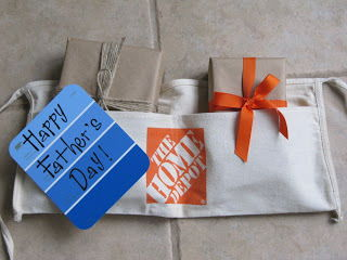 apron from Home Depot (or any hardware store), brown craft paper, paint chips and ribbon or string
