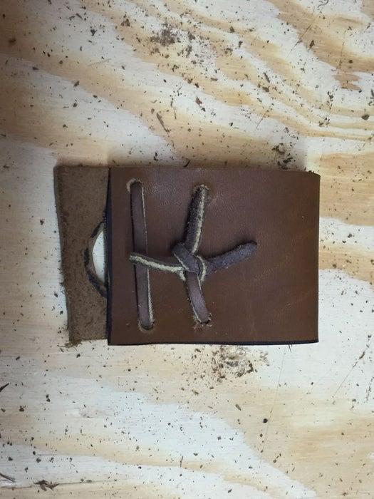 DIY leather thumb guard.