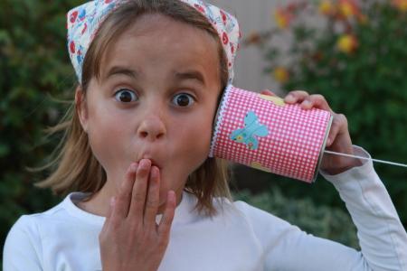 a girl using Tin Can Phone