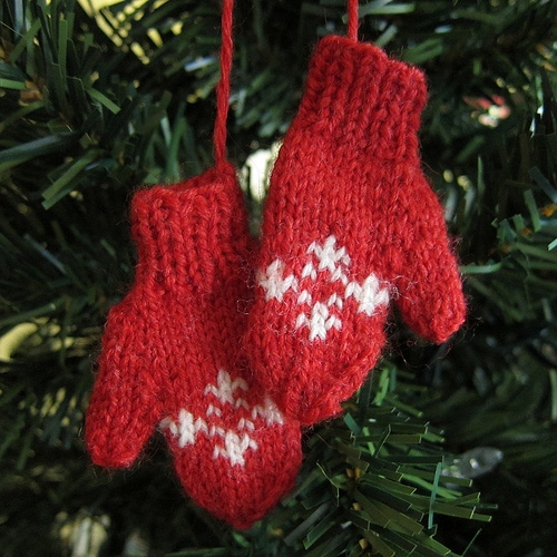 Red mitten ornament hanging on Christmas tree