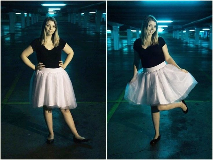 a woman in black shirt and tulle skirt in the parking lot