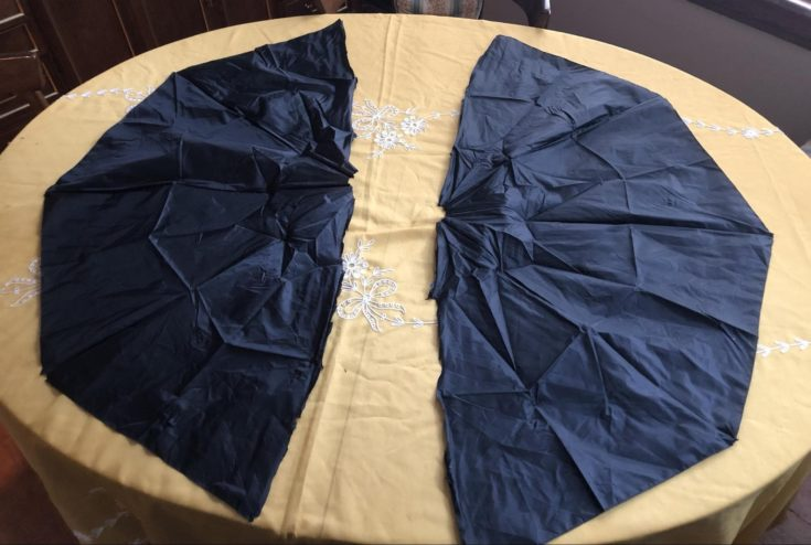 Two umbrella black fabric placed above on the table with yellow cloth cover