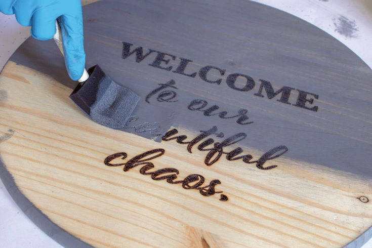 staining the wood sign with the Weathered Gray stain by Varathane