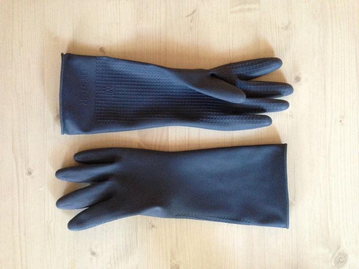black gloves in wooden background