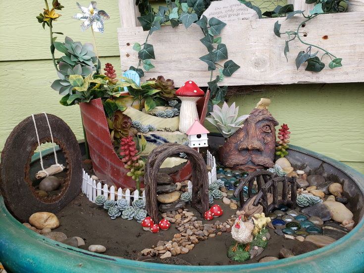 Fairy Garden on large pot, flowers, figurines