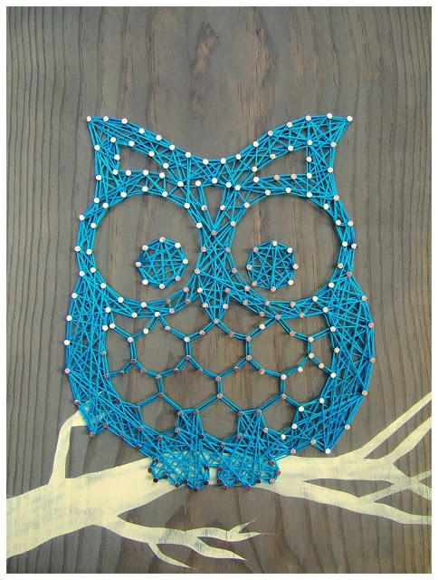 Wise Owl blue string art design.