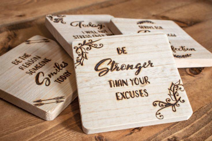 Wood burning text on coasters.