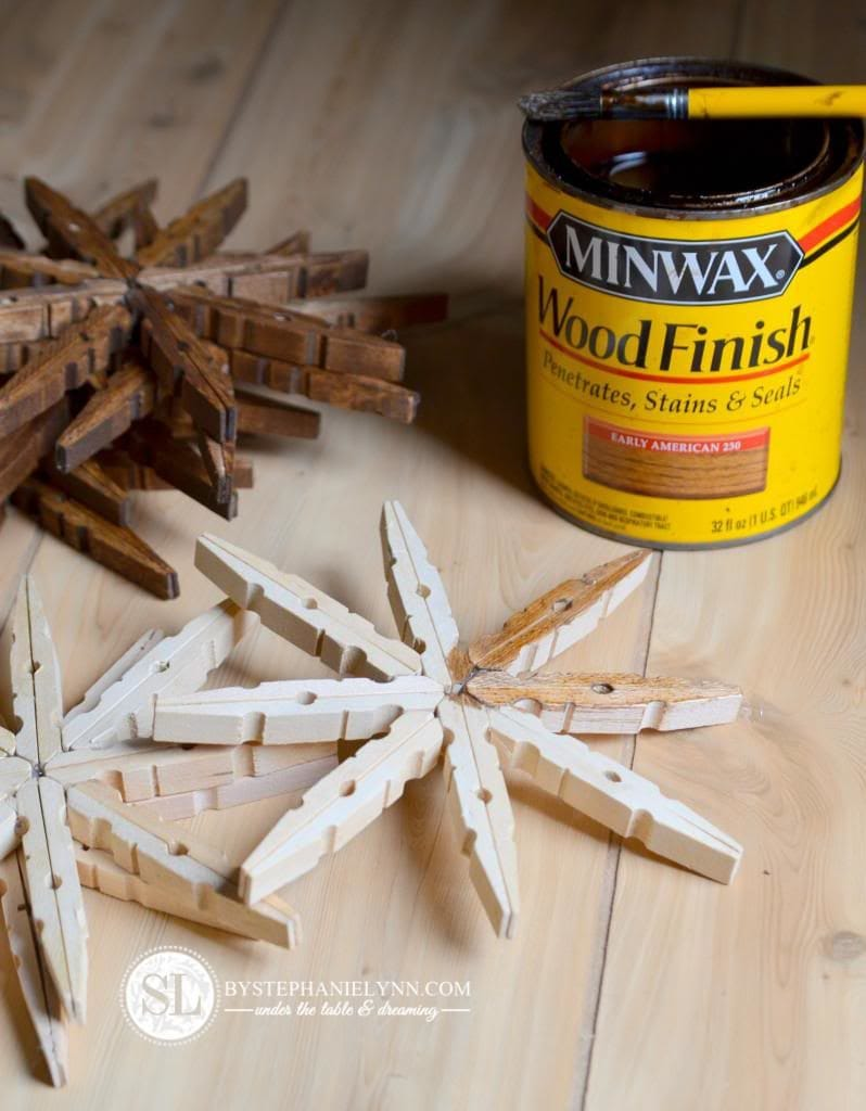 DIY wood clothes pins snowflakes on wooden floor with a can of winmax wood finish