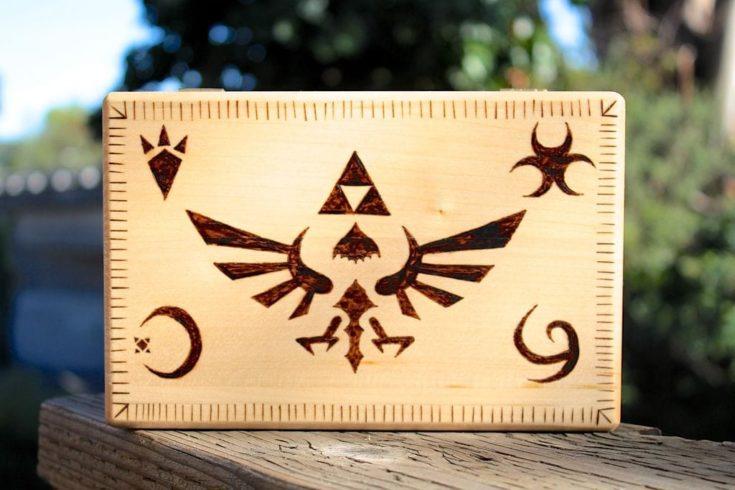a wooden box with legend of selda wood burn design