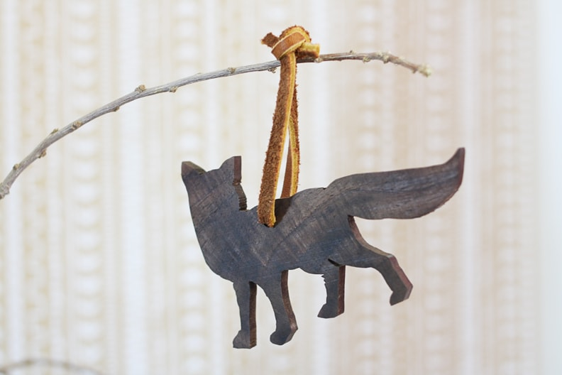 Wooden Fox Tied to a Twig Using a Brown Leather