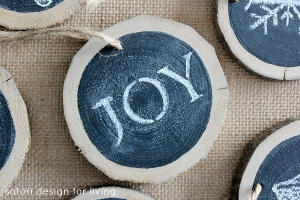 Blue circle woodslice with joy text ornaments with satori design for living written on foreground