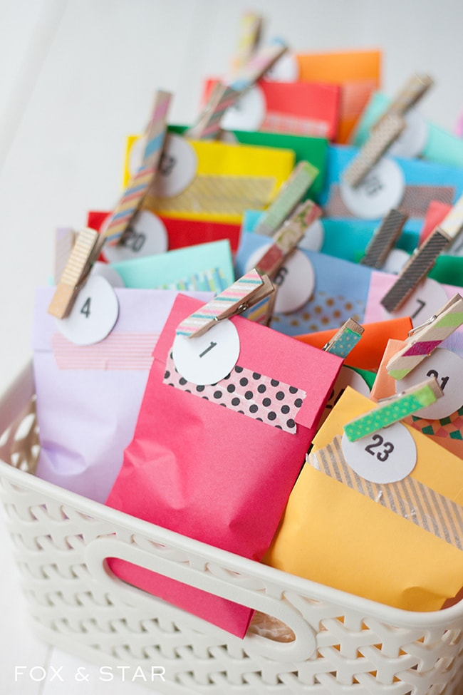 Fox and Star colorful envelops with clothes pins on the corner inside a white plastic basket