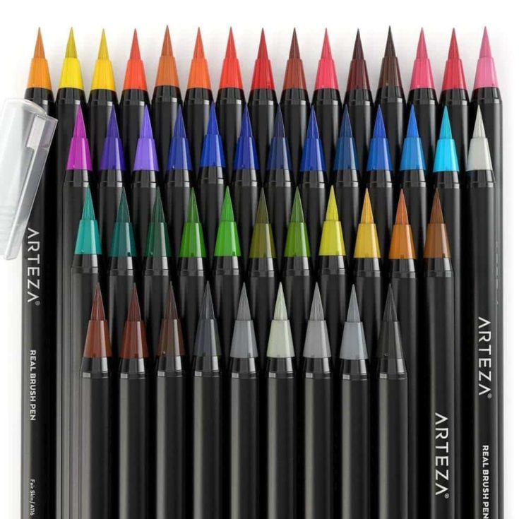 a set of arteza real brush pens isolated in white background