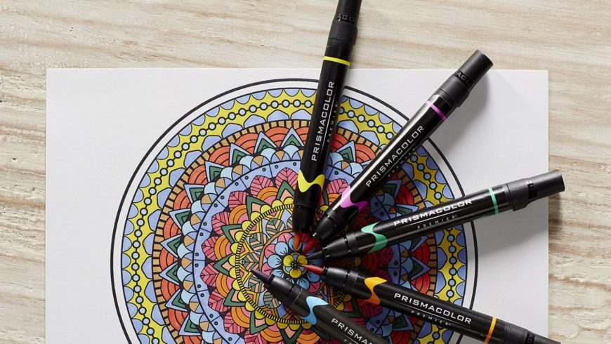 Beautiful Art with mandala markers in wooden background