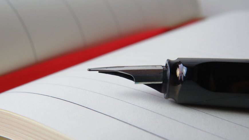 Close up shot of notebook and pen