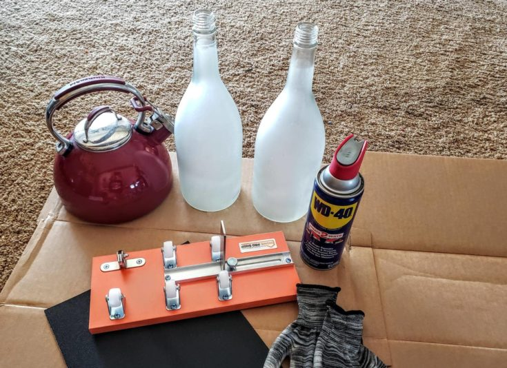 Wine Bottle + Kettle for hotwater + Pair of Gloves + Lubricant Oil + Bottle Cutter Frame + Sand Paper