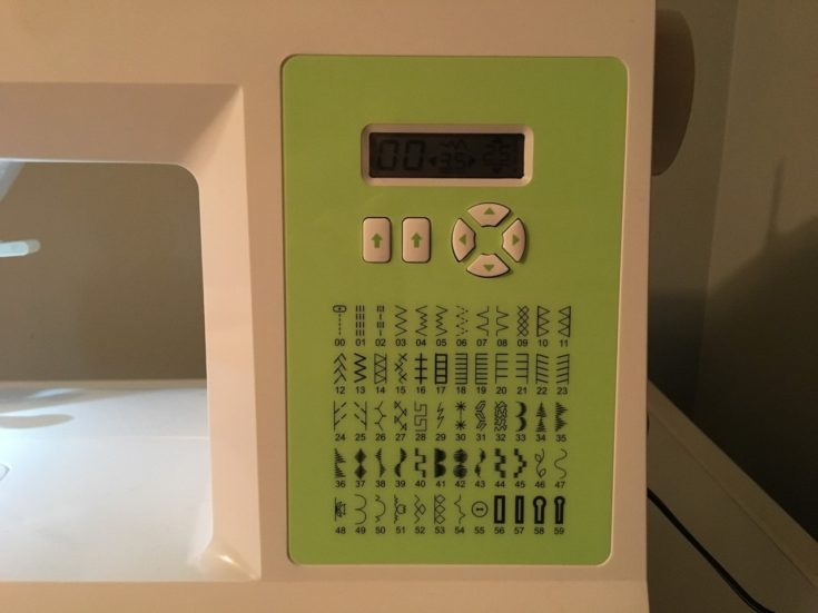 button controls of the sewing machine