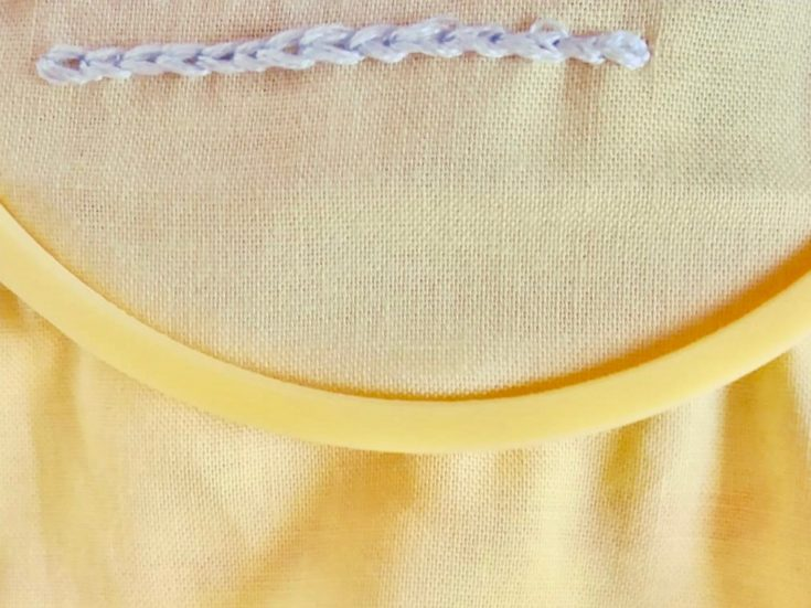 chain stitch embroidery example in a yellow cloth