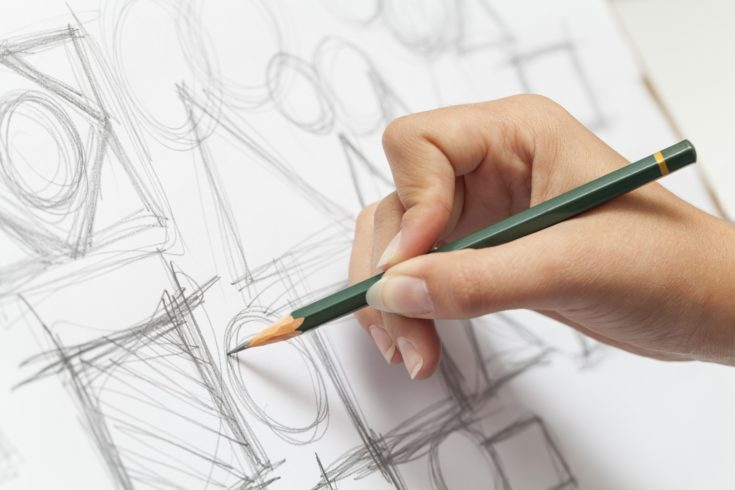 Close-up photograph of a designer making sketch