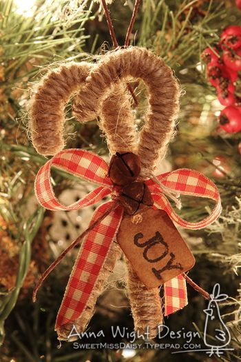 Anna Wight jute candy cane with red plaid ribbon and joy tag