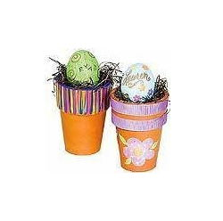 DIY Easter terracotta pots with decorated eggs on top.