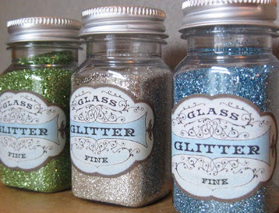 Mason jar with labels and filled with glitters.