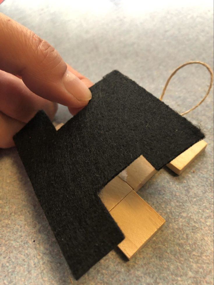 Cut adhesive black felt paper fit to the form scrabble letters.
