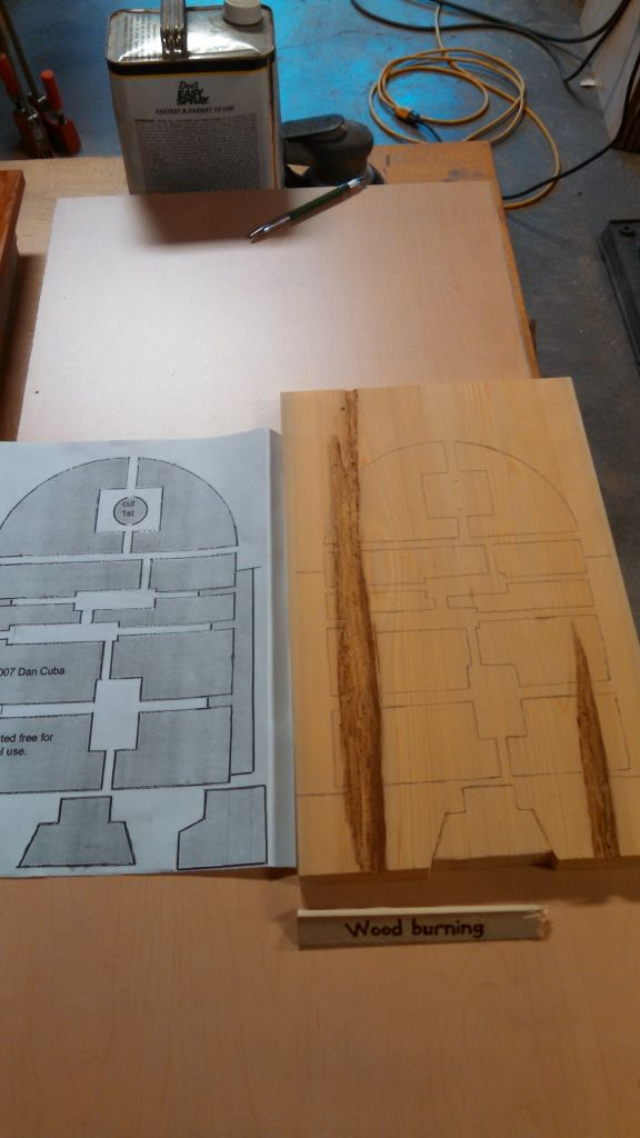 recreating the design into the wood using transfer paper