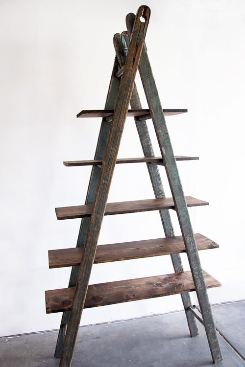 5 layers wooden ladder with white wall background