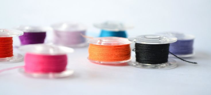Colorful threads on bobbins.